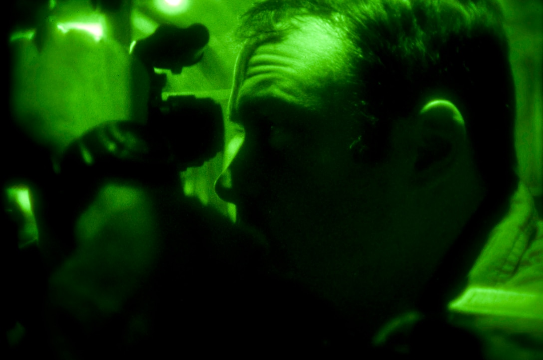 1st. Lt. Brandon Mahoney, 139th Airlift Wing, Mo. Air National Guard, tests his night vision goggles before a Haiti relief mission on February 6, 2010. (U.S. Air Force photo by Master Sgt. Shannon Bond/Released)