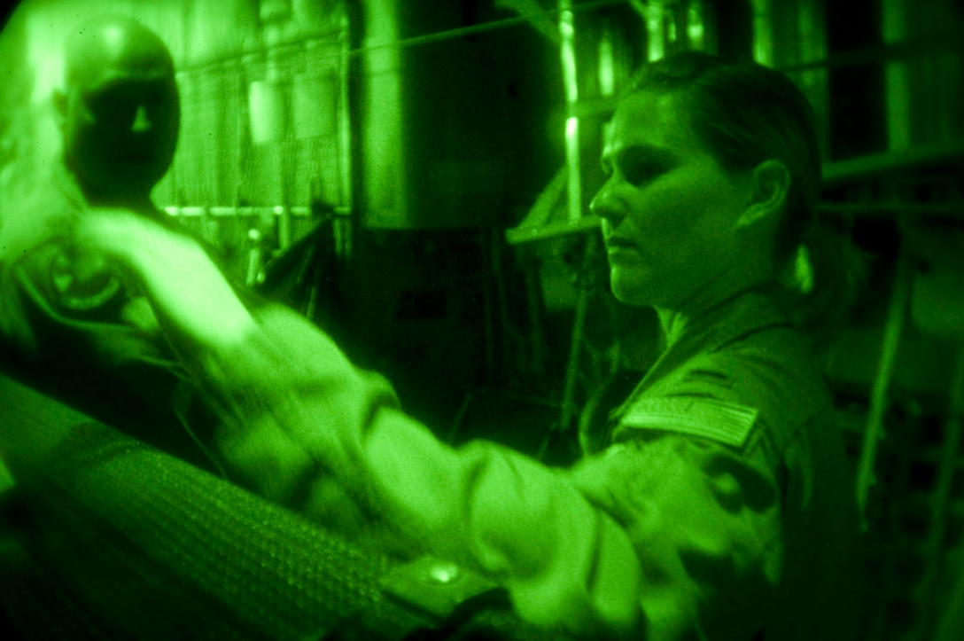 1st. Lt. Jennifer Howard, 139th Airlift Wing, Mo. Air National Guard, tests her night vision goggles before a Haiti relief mission on February 6, 2010. (U.S. Air Force photo by Master Sgt. Shannon Bond/Released)