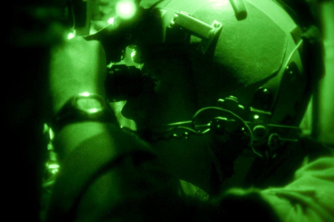Lt. Col. Brad Crabtree, 139th Airlift Wing, Mo. Air National Guard, tests  his night vision goggles before a night time relief mission to Haiti on February 6, 2010. (U.S. Air Force photo by Master Sgt. Shannon Bond/Released)