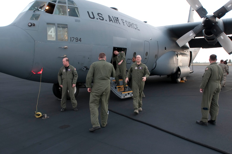 139th Airlift Wing, Mo. Air National Guard, aircrew members prepare their C-130 for departure from Homestead Air National Guard base, Florida, for relief efforts in Haiti on February 6th, 2010. (U.S. Air Force photo by Master Sgt. Shannon Bond/Released)