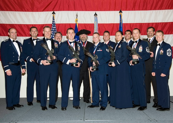 The 53rd Wing honored its annual award winners during a ceremony held Feb. 4. Col. Michael Gantt, 53rd Wing commander(far left) and Chief Master Sgt. William Harner, Wing command chief (far right) pose with this year's winners. The winners include: Master Sgt. Gene W. Sing, 53rd Weapons Evaluation Group, first sergeant of the year; Airman 1st Class Joseph H. Eckert, 68th Electronic Warfare Squadron, airman of the year; Staff Sgt. Bryan S. Moore, 422 Test and Evaluation Squadron, NCO of the year; Master Sgt. Terry L. Wenger, 28th Test and Evaluation Squadron, senior NCO of the year; 1st Lt. Simone Shen, 453rd Electronic Warfare Squadron, CGO of the year; Maj. Jeffrey R. Elliott, 28th Test and Evaluation Squadron, FGO of the year; Carl D. Elderidge (not pictured), 53rd Training Systems Squadron, Civilian Category I; Elisa R. Flores (not pictured), 53rd Test and Evaluation Group, Civilian Category II; Richard D. Degraw, 85th Test and Evaluation Squadron, Civilian Category III; Roger L. Muse, 31st Test and Evaluation Squadron, Civilian Category IV; and Anthony L. Ordner, 28th Test and Evaluation Squadron, Civilian Category V.