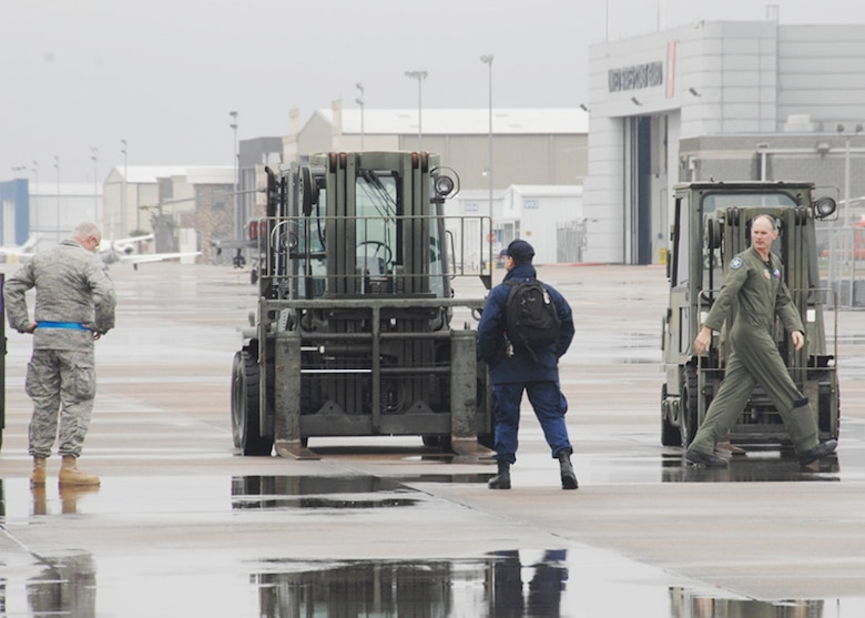 147th Reconnaissance Wing member wait to unlaod trucks carrying equipment for Texas Task Force One at Ellington Field Joint Reserve Base, Houston Texas, January 14, 2010.  147 RW photo by: Msgt Dale Hanson
