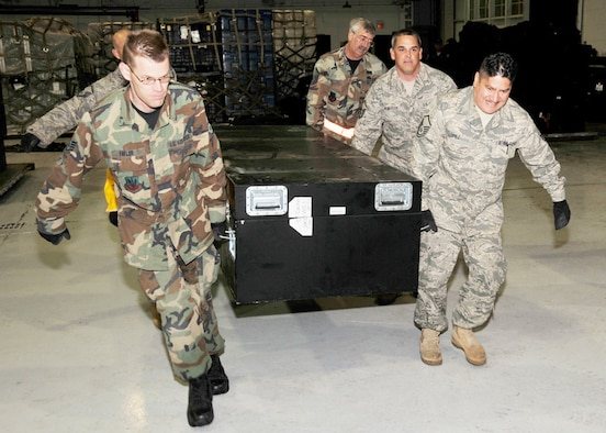 147th Reconnaissance Wing members move equipment belonging toTexas Task Force One to an air transport pallet at Ellington Field Joint Reserve Base Houston Texas 14 January 2010.  147 RW photo by: MSgt Dale Hanson