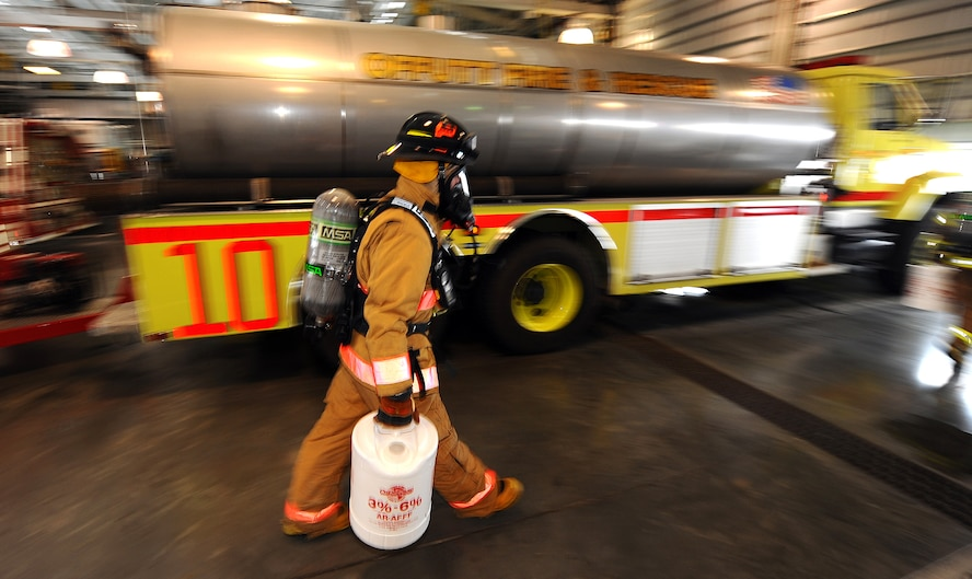 OFFUTT AIR FORCE BASE, Neb.- Tyler Carr, 55th Civil Engineering Squadron firefighter, goes through a barrage of tests intended to get his breathing and heart rate up inside the fire station's garage Feb. 5.  The tests evaluated the new fire hawk mask to be implemented Air Force wide in the coming weeks. Daily equipment tests are part of a firefighter's job and help ensure mission readiness. U.S. Air Force photo by Josh Plueger