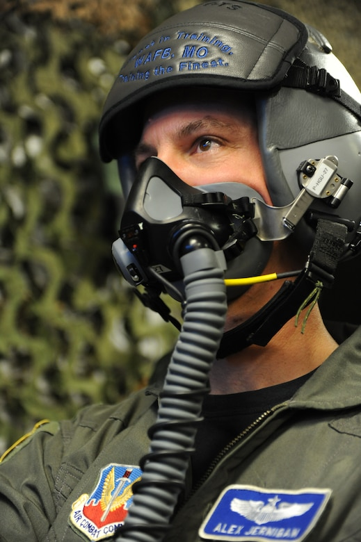 WHITEMAN AIR FORCE BASE, Mo. - Maj. Alex Jernigan, Detachment 12 commander, is supplied oxygen during hypoxia recognition training, Feb. 8, 2010. The training is used as a refresher course in recognizing individual signs of hypoxia, a deficiency of oxygen to the body that is sufficient enough to cause an impairment of function. (U.S. Air Force photo/Airman 1st Class Carlin Leslie)(Released)