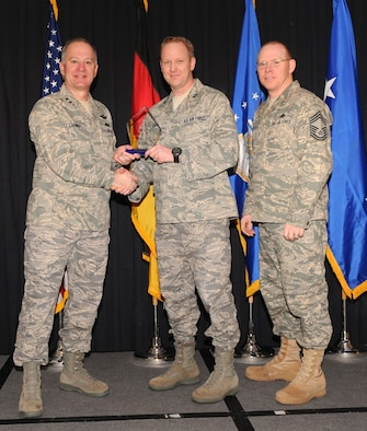 Maj. Gen. Ronald Ladnier, 17th Air Force Commander (left), and Chief Master Sgt. Steven Scott, acting 17th AF Command Chief (right), present the 2009 CGO of the Year award to Capt. Adam Clary, (A2), during the annual awards breakfast Feb. 9.