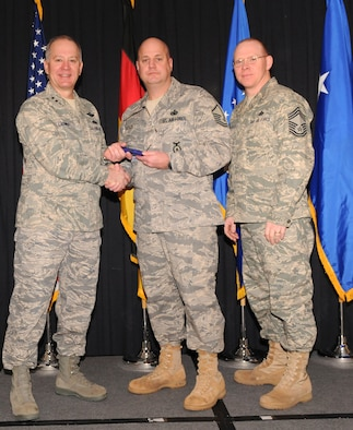 Maj. Gen. Ronald Ladnier, 17th Air Force Commander (left), and Chief Master Sgt. Steven Scott, acting 17th AF Command Chief (right), present the 2009 SNCO of the Year award to Master Sgt. Michael Keeler, (A4/7) during the annual awards breakfast Feb. 9.