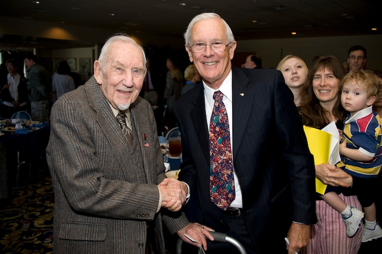 Retired Brig. Gen. Charles Duke Jr., right, poses for a photo with John Eck at the Air Force Academy's National Prayer Luncheon Feb. 9, 2010. General Duke, a former astronaut who walked on the Moon's surface, was the luncheon's guest speaker. Mr. Eck is a survivor of the Dec. 7, 1941 attack on Pearl Harbor. (U.S. Air Force photo/Bill Evans)
