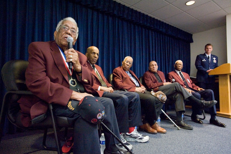 """Tuskegee Airmen Thomas Ellis (left to right), Dr. Granville Coggs, Warren Eusan, Dr. Gene Derricotee and John """"Mule"""" Miles answer questions from the audience after the second annual Tuskegee Heritage Breakfast Feb. 8 at the 99th Flying Training Squadron here. (U.S. Air Force photo/Steve Thurow)"""