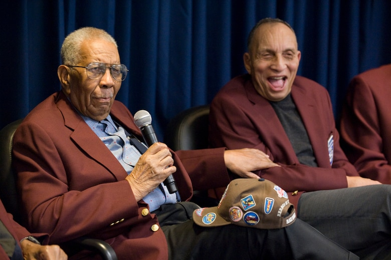 Warren Eusan and Dr. Gene Derricotte talk with the audience about their experiences as Tuskegee Airmen at the second annual Tuskegee Heritage Breakfast Feb. 8 at the 99th Flying Training Squadron here. (U.S. Air Force photo/Steve Thurow)