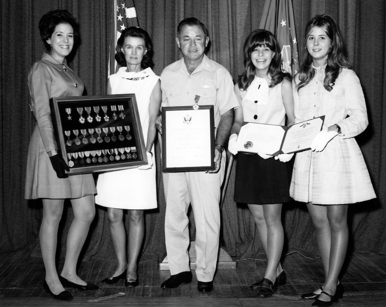 "Col. Joe Davis Jr. at his retirement from the U.S. Air Force with his ""Four Queens,"" (left to right) daughter Scott, wife Ann, and daughters Chris and Jan in 1969. (U.S. Air Force photo)"