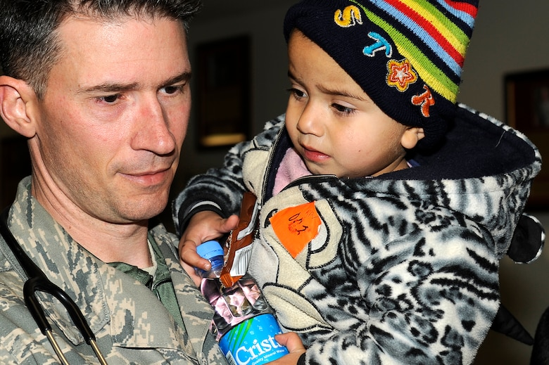 U.S. Air Force Master Sgt. Jan Fink, 455th Expeditionary Medical Group, holds a young avalanche survivor who was medically evacuated to Craig Joint Theater Hospital, Bagram Airfield, Feb. 9, 2010. Dozens of Afghans were taken to Bagram Airfield after an avalanche struck a mountain pass in the Parwan province in north eastern Afghanistan. (U.S. Air Force photo by/ Tech. Sgt. Jeromy K. Cross/released)