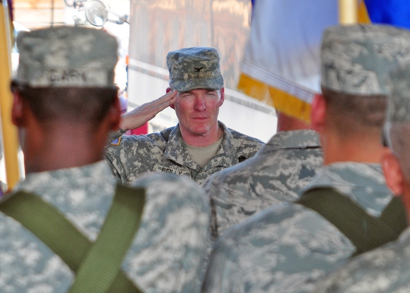 Army Col. Gregory Reilly salutes his Soldiers, Airmen, Sailors and Marine as he assumes command of Joint Task Force-Bravo from Air Force Col. Eric Snadecki during a change of command ceremony at the Soto Cano Fire Department February 9. (U.S. Air Force Photo/Staff Sgt. Bryan Franks)