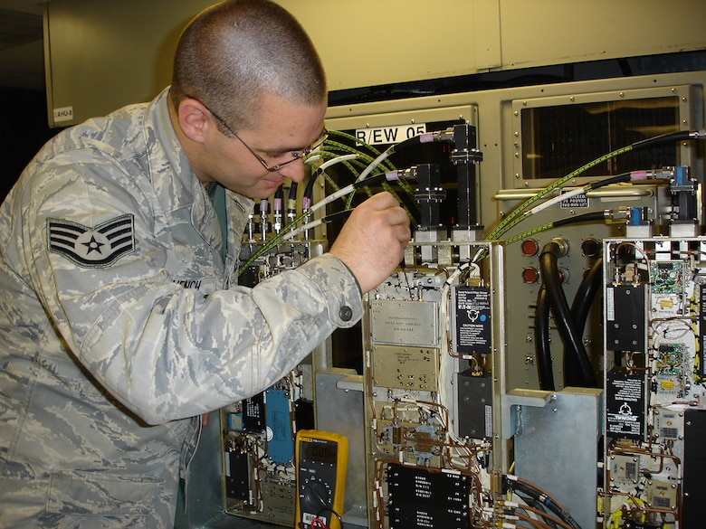 Staff Sgt. Karl Muench Jr., of the 7th Component Maintenance Squadron, Dyess AFB,Texas, performs frequency adjustments to a B-1 Band 4-8 receiver mounted on a Radar and Electronic Warfare test station.  The Band 4-8 Receiver recently underwent a B1-B Repair Network Integration proof of concept live test. The test demonstrated whether the repair network could re-optimize and balance capacities to meet a workload requirement of 15 serviceable assets within a 90- day period. (U.S. Air Force Photo/ MSgt Kenneth Bamberger)
