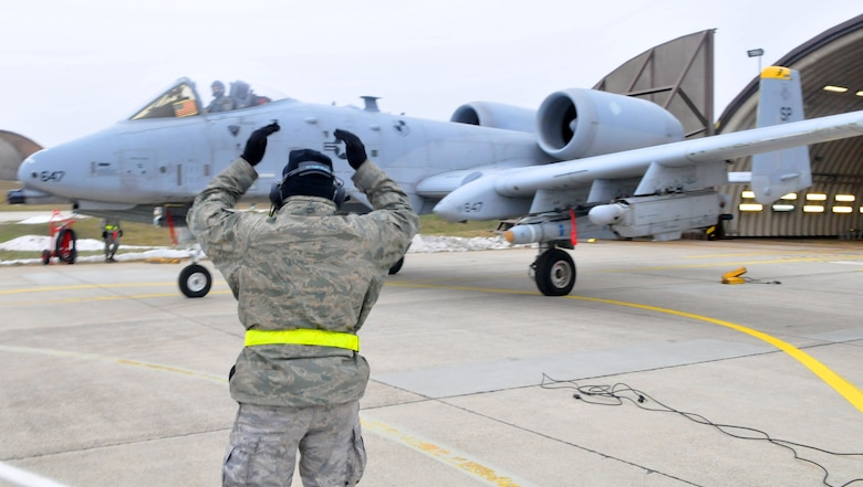SPANGDAHLEM AIR BASE, Germany -- Airman 1st Class Savon Scales, 52nd Aircraft Maintenance Squadron crew chief, marshalls an A-10 Thunderbolt II prior to launch Feb. 9 on the flightline. (U.S. Air Force photo/Airman 1st Class Nick Wilson)