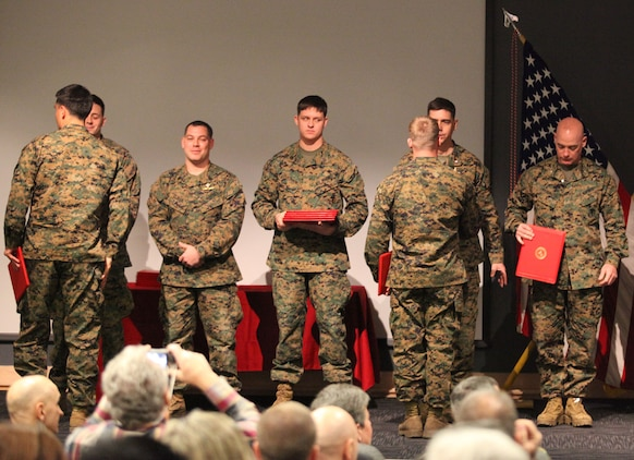 U.S. Marine Corps Forces, Special Operations Command, Marine Special Operations School instructors and Col. James Parrington, the commanding officer of MSOS, congratulate the newest Marine special operators Feb. 11, at the MARSOC headquarters building auditorium. The Marines went through a grueling seven-month course that tested them physically and mentally.