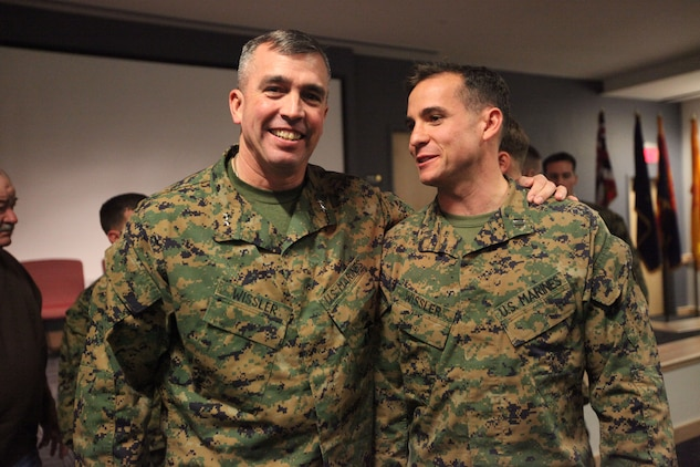 Maj. Gen. John E. Wissler, deputy commanding general of II Marine Expeditionary Force stands with his son Feb. 11 at the U.S. Marine Corps Forces, Special Operations Command headquarters building auditorium. Wissler's son is one of 40 Marines who graduated from the second ever Individual Training Course and earned the title Marine Special operator.