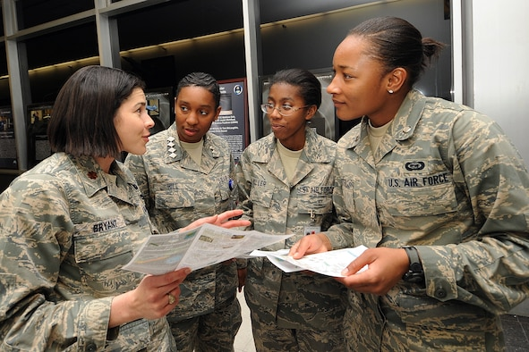 MAj. Elaine Bryant discusses the aeronautics major program with Cadet Candidates Jazmind Hill, Acacia Miller and Enicia Porter during Majors' Night at the Air Force Academy Feb. 11, 2010. Aeronautics is one of 32 fields of study available at the Academy. Major Bryant is an instructor with the Department of Aeronautics. The cadet candidates are students at the Academy Preparatory School. (U.S. Air Force photo/Rachel Boettcher)