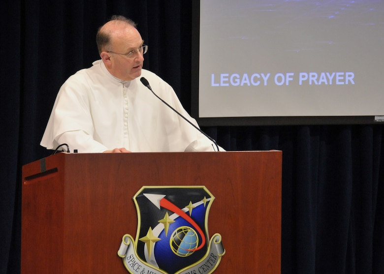 Father Martin Benzoni, the base Catholic priest, recited a prayer from President John F. Kennedy at the base's prayer breakfast, Feb. 3. (Photo by Lou Hernandez)