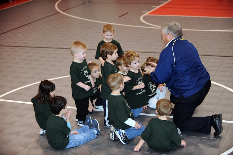 WHITEMAN AIR FORCE BASE, Mo. - Mike Orrison gathers the participants of the Start Smart youth sports program at the end of class Feb. 12, 2010. Mr. Orrison instructed the Start Smart class for parents and children ages 3-to 5 years-old. The program provides parents the opportunity to assist their child in learning sports fundamentals. (U.S. Air Force photo/Tech. Sgt. Charles Larkin Sr)