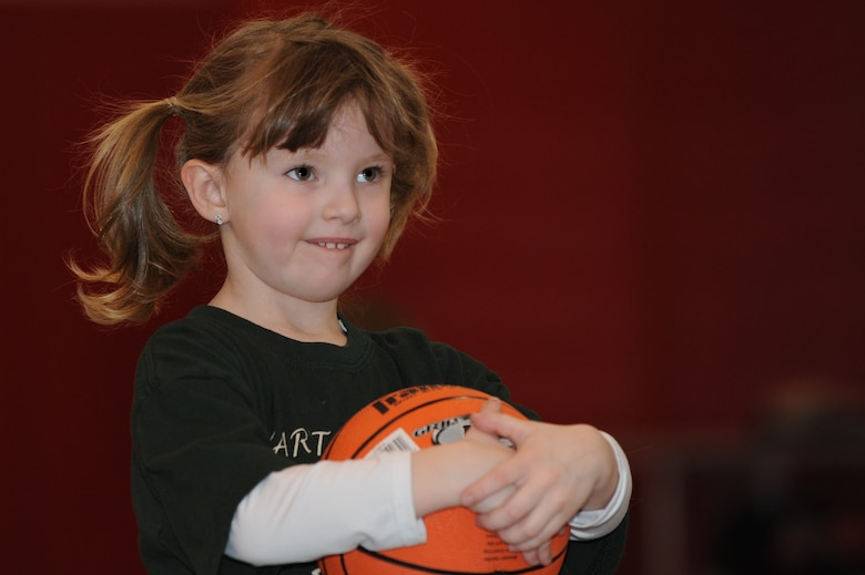 WHITEMAN AIR FORCE BASE, Mo. - Elizabeth Derheim awaits instructions during the Start Smart youth sports program Feb. 12, 2010.Whiteman Youth Center provides the Start Smart program to children ages 3-to 5-years-old. The children spent the hour learning basketball fundamentals and spending quality time with their parents. (U.S. Air Force photo/Tech. Sgt. Charles Larkin Sr)