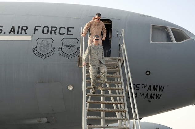 Lt. Gen. Rusty Findley, Air Mobility Command vice commander at Scott Air Force Base, Ill., steps down from a KC-10 Extender deployed with the 908th Expeditionary Air Refueling Squadron at a non-disclosed base in Southwest Asia on Feb. 11, 2010. General Findley was getting an overview of the KC-10 mission with the 908th EARS during his visit to the 380th Air Expeditionary Wing. The KC-10 in the photo is deployed from Joint Base McGuire-Dix-Lakehurst, N.J.  (U.S. Air Force Photo/Master Sgt. Scott T. Sturkol/Released)