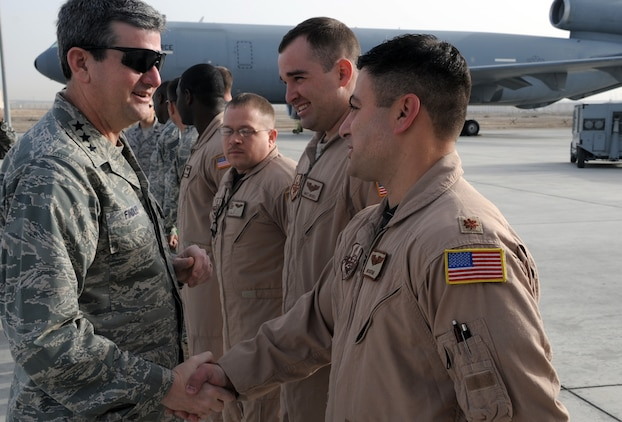 Lt. Gen. Rusty Findley, Air Mobility Command vice commander at Scott Air Force Base, Ill., greets with Maj. Ben Yosfan and other mobility Airmen of the 380th Air Expeditionary Wing at a non-disclosed base in Southwest Asia on Feb. 11, 2010. General Findley visited the 380th AEW as part of a trip through the U.S. Central Command area of responsibility. (U.S. Air Force Photo/Master Sgt. Scott T. Sturkol/Released)