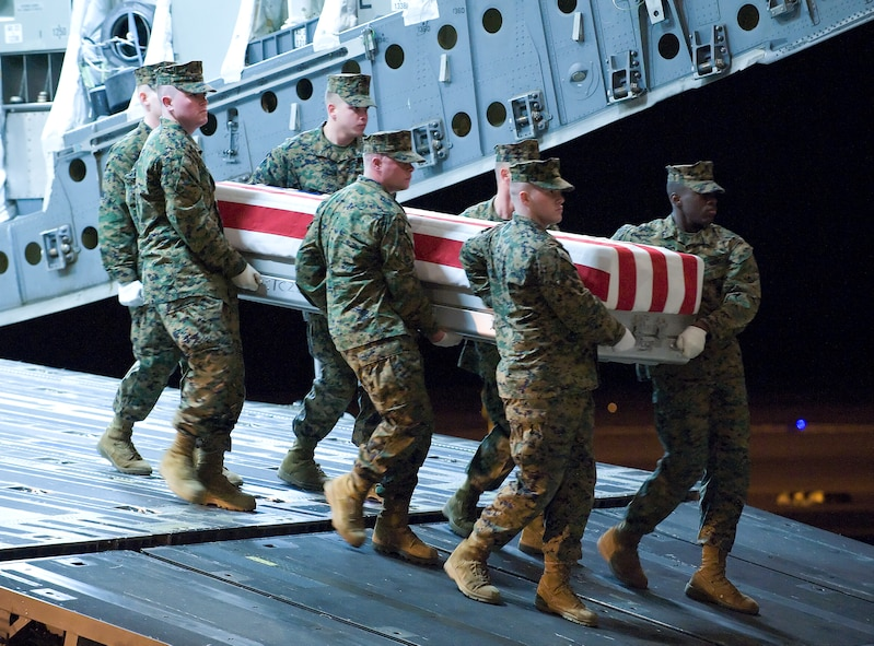 A U.S. Marine Corps team transfers the remains of Marine Corps Cpl. Jacob H. Turbett, of Wayne, Michigan, at Dover Air Force Base, Del., on February 14, 2010.  (U.S. Air Force photo/Brianne Zimny)
