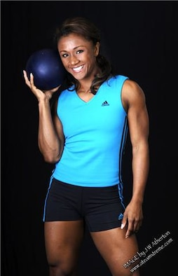 """U.S. Air Force Academy graduate Tanji Johnson will host a one-hour """"Gladiator Boot Camp"""" workout at the Women's History Month Fitness Fair, noon, March 24, at the Peterson Fitness and Sports Center, Building 560. Gladiator Boot Camp is open to everyone and features the front crawl, crossing plank glides, military press, lunges and bicep curls. The fair begins at 11 a.m. and features health and nutrition information from the Health and Wellness Center and prizes for participants. (Photo courtesy of Ms. Johnson)"""