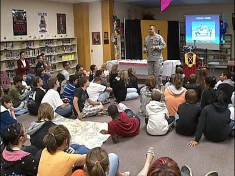 Major Robert Baird an Air Force Reservist from the 507th Air Refeuling Wing recently received a lifesaving award from actions performed in his civilian job as a Broken Arrow, Oklahoma police officer.  The major is shown here in a May 2009 file photo presenting a speech to a Broken Arrow elementary classroom on his military experiences.