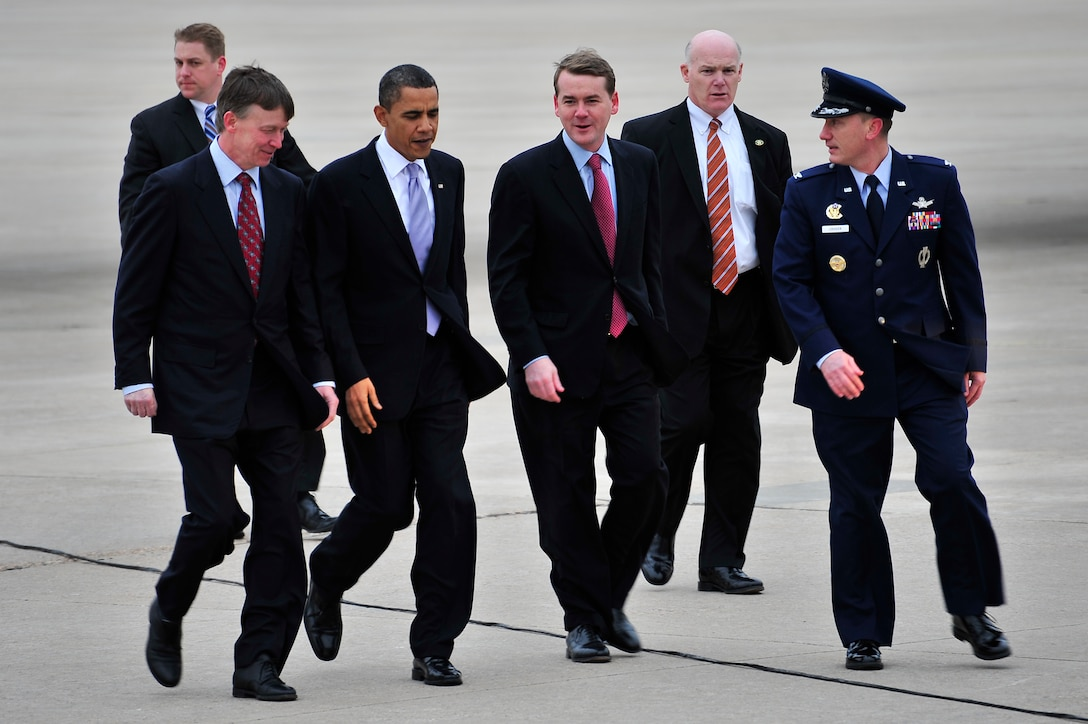 BUCKLEY AIR FORCE BASE, Colo. -- President Barack Obama is escorted by Col. Clint Crosier, right, 460th Space Wing commander, Feb. 18. President Obama is attending a fund-raiser in Denver this week. (U.S. Air Force photo by Senior Airman Kathrine McDowell)
