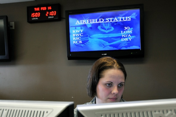 OFFUTT AIR FORCE BASE, Neb. - Staff Sgt. Savanna Layton, with the 55th Operations Support Squadron, checks the schedule for incoming aircraft at base operations Feb. 16. The Airfield Operations Flight airfield management team coordinates with various base agencies to provide a safe environment for aircraft operations. 