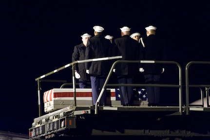 A U.S. Navy team transfers the remains of Navy Petty Officer 1st Class Sean L. Caughman, at Dover Air Force Base, Del., February 17. (U.S. Air Force photo/Roland Balik)