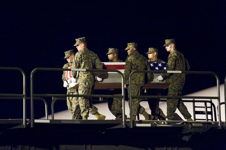 A U.S. Marine Corps team transfers the remains of Marine Corps Pfc. Jason H. Estopinal, of Dallas, Ga., at Dover Air Force Base, Del., February 17. Pfc. Estopinal was assigned to 2nd Battalion, 2nd Marine Regiment, 2nd Marine Division, II Marine Expeditionary Force, Camp Lejeune, N.C. (U.S. Air Force photo/Roland Balik)