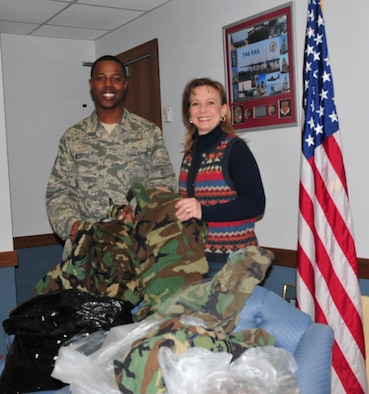 Senior Airmen Christopher George of the 914 Airlift Wing Raising 6 Organization presents 1st Lt. Tina Warnock of the Civil Air Patrol,TAC Composite Squadron with surplus military uniforms donated by unit members.The CAP was on base for the Western New York Group Leadership Development school that brings over100 CAP Cadets from units all over New York State to Niagara for a full weekend of leadership classes and exercises. 1st Lt. Warnock stated that cadets as young as 12 years old join the Civil Air Patrol, which is an auxiliary of the Air Force and are required to buy their own uniforms. Any donation of uniform items is appreciated as some do not have the resources to purchase their own uniforms. ( U.S Air Force photo by Staff Sgt. Everett Myrick)