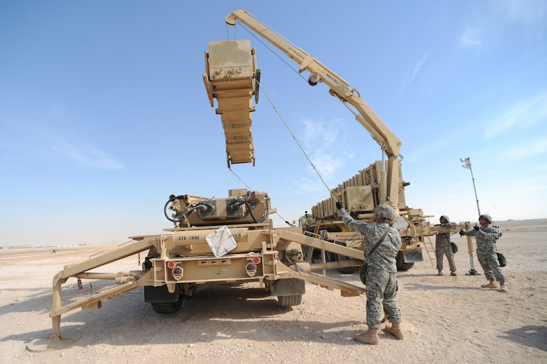 Army Patriot Launch Station operator/maintainers from Bravo Battery, 1-43 Air Defense Artillery, perform a guided-missile transporter reload certification activity at a non-disclosed Southwest Asia location, Feb. 12, 2010. (U.S. Air Force photo by Tech. Sgt. Michelle Larche)[RELEASED]