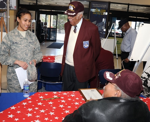 Cadet Candidate Indigo Blakely meets with Samuel Hunter Jr. and retired Lt. Col. Lowell Bell during a Tuskegee Airmen presentation at the Air Force Academy Base Exchange Feb. 16, 2010. Mr. Hunter is an original Tuskegee Airman; Colonel Bell and retired Chief Master Sgt. Loran Smith (not pictured) are second-generation Tuskegee Airmen who visited the Academy in celebration of Black History Month. Cadet Candidate Blakely is a student at the Academy Preparatory School. (U.S. Air Force photo/Johnny Wilson)