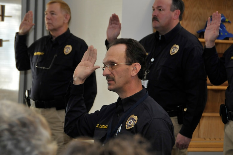 Arnold Air Force Base police officer Steve Luttrell, middle, recites the official police oath during a Police Officer Standards and Training certification event at the base Feb. 19. Officers Dave Everett, left, and Buck Young also recite the oath. (Photo by Rick Goodfriend)