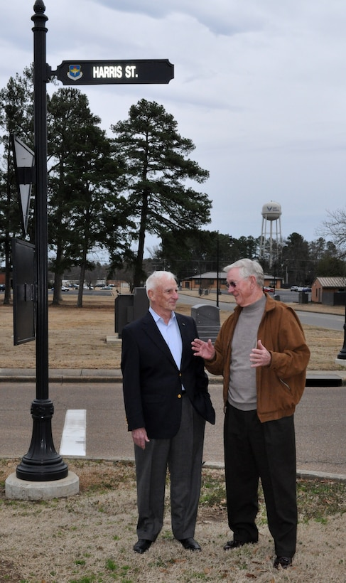 """Retired Col. Carlisle """"Smitty"""" Harris talks with retired Lt. Col. Richard """"Gene"""" Smith at the street named in honor of Colonel Harris in 2007 on Thursday Feb. 11.  Colonel Harris, now residing in Tupelo, Miss.,  was a POW in Vietnam for nearly eight years  and is credited for improvising the """"Tap Code"""" while held in captivity. Lt Col Smith, residing in West Point, Miss., was a POW in Vietnam for five and a half years and the wing ceremonial plaza is named in his honor.  Feb 12 marked the 37th anniversary of Colonel Harris' repatriation.  Both former POW's visited Columbus AFB to participate in the Maj/Lt Col promotion party at the Columbus Club. (U.S. Air Force photo/SrA Jacob Corbin)"""