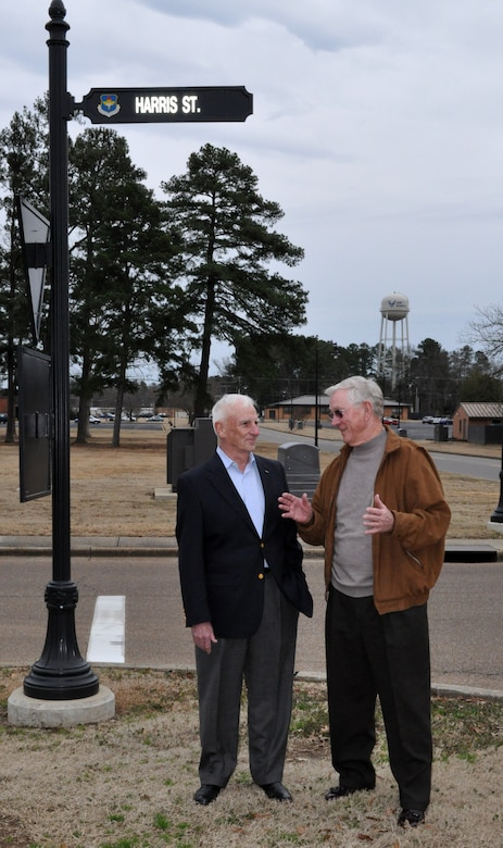 "Retired Col. Carlisle ""Smitty"" Harris talks with retired Lt. Col. Richard ""Gene"" Smith at the street named in honor of Colonel Harris in 2007 on Thursday Feb. 11.  Colonel Harris, now residing in Tupelo, Miss.,  was a POW in Vietnam for nearly eight years  and is credited for improvising the ""Tap Code"" while held in captivity. Lt Col Smith, residing in West Point, Miss., was a POW in Vietnam for five and a half years and the wing ceremonial plaza is named in his honor.  Feb 12 marked the 37th anniversary of Colonel Harris' repatriation.  Both former POW's visited Columbus AFB to participate in the Maj/Lt Col promotion party at the Columbus Club. (U.S. Air Force photo/SrA Jacob Corbin)"