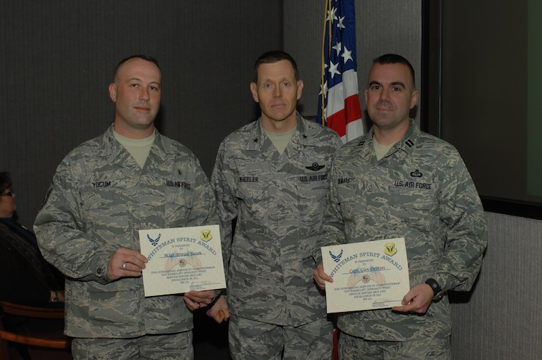 WHITEMAN AIR FORCE BASE, Mo. - Brig. Gen. Robert Wheeler, 509th Bomb Wing commander, presented Capt. Glen DeMars, 509th Operations Support Squadron, and Master Sgt. Britian Yocum, 509th Medical Support Squadron, with the Whiteman Spirit Award Feb. 17, 2010. (U.S. Air Force photo/Staff Sgt. Lauren Padden)