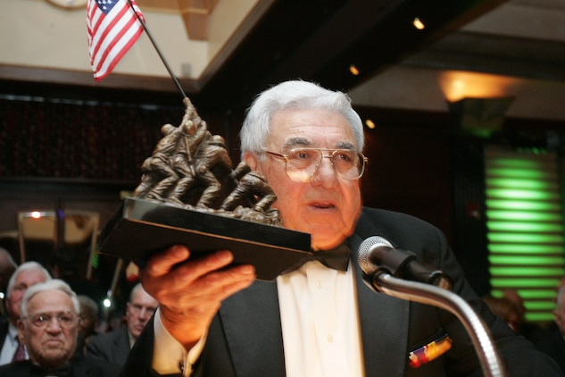 Angelo Ciotta, president of the Iwo Jima Survivors of New York, presents a statue of the flag raising at Iwo Jima, an iconic Marine Corps battle, to fellow Iwo Jima veterans at the 2010 Iwo Jima Survivors of New York Dinner, February 20, 2010 at the Chateau Briand, Carle Place, New York.  The memorial dinner was hosted by Hope for the Warriors, in honor of the 65th Anniversary of the battle of Iwo Jima. (Official Marine Corps photo by Staff Sgt. Alana M. Pereira)
