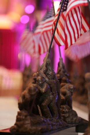 Statues of the flag raising at Iwo Jima, an iconic Marine Corps battle, were presented to Iwo Jima veterans at the 2010 Iwo Jima Survivors of New York Dinner, February 20, 2010 at the Chateau Briand, Carle Place, New York.  The memorial dinner was hosted by Hope for the Warriors, in honor the 65th Anniversary of the battle of Iwo Jima. (Official Marine Corps photo by Sgt. Randall A. Clinton)