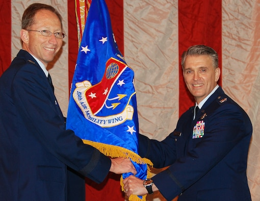 Colonel Giordano McMullen (right) accepts the 514th Air Mobility Wing guidon from Maj. Gen James Rubeor, 22nd Air Force commander, during a change-of-command ceremony at Joint Base McGuire-Dix-Lakehurst, NJ, February 21, 2010. Colonel McMullen had served as the wing's vice commander since October 2008. He also has experience as a wing commander, serving as the commander of the 913th Airlift Wing at Willow Grove Air Reserve Station, Penn., from April to October 2007. (U.S. Air Force photo/Staff Sgt. Shawn J. Jones)