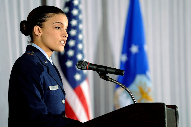 Second Lt. Tasia Tindle introduces Colorado Rep. Terrance Carroll at a Black History Month Luncheon held at the U.S. Air Force Academy's Falcon Club Feb. 22, 2010. Mr. Carroll, the speaker of the Colorado House of Representatives, was the guest speaker for the luncheon. Lieutenant Tindle is a readiness officer with the 10th Force Support Squadron and a graduate of Louisiana State University. (U.S. Air Force photo/Mike Kaplan)