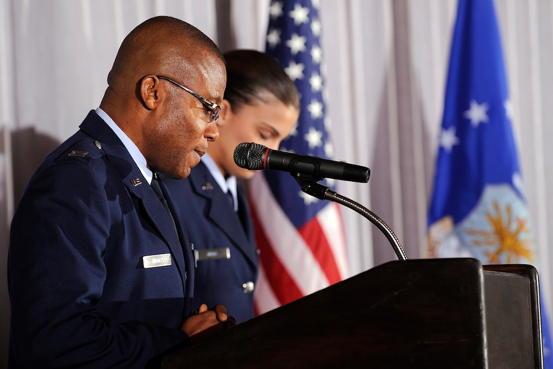 Chaplain (Capt.) Laserian Nwoga performs an invocation at the Black History Month Luncheon at the U.S. Air Force Academy's Falcon Club Feb. 22, 2010. Colorado Rep. Terrance Carroll, the speaker of the Colorado House of Representatives, was the luncheon's guest speaker. Chaplain Nwoga is assigned to the 10th Air Base Wing Chapel. (U.S. Air Force photo/Mike Kaplan)