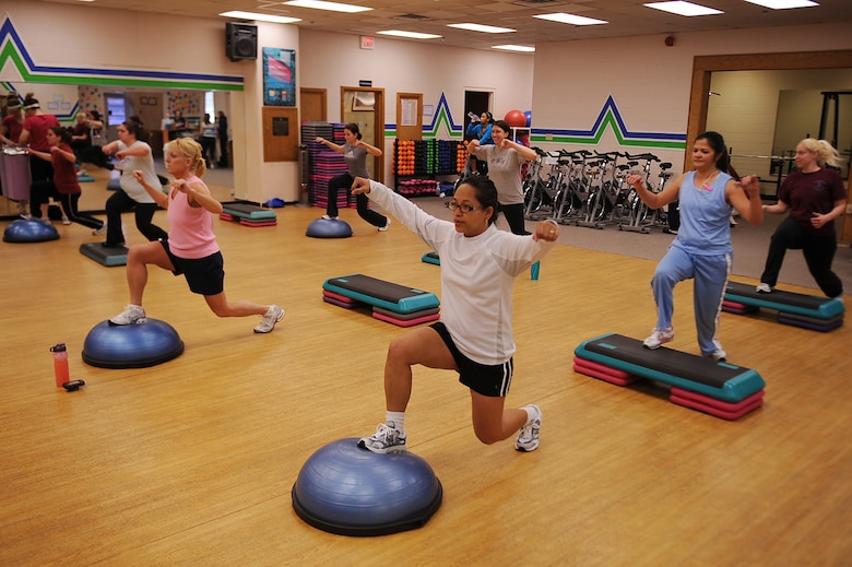Members of Bellamorphosis women's health club participate in a cardio challenge workout class on Seymour Johnson Air Force Base, N.C., Feb. 22, 2010. Bellamorphosis offers more than 70 classes taught by certified instructors or personal trainers. (U.S. Air Force photo/Senior Airman Ciara Wymbs)