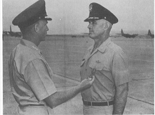 Lt. Col. William Boyd, 314th Tactical Airlift Wing, is being presented the Air Force Cross May 12, 1968 for his actions at Kham Duc. (Courtesy photo)