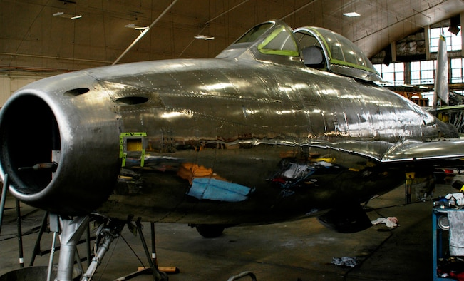 """DAYTON, Ohio (02/2010) -- This F-84 is currently undergoing restoration at the National Museum of the U.S. Air Force. Once completed, the aircraft will feature the brightly colored artwork from Col. Joseph Davis Jr.'s aircraft, an F-84G nicknamed """"Four Queens,"""" which he flew during the Korean War. (U.S. Air Force photo)"""