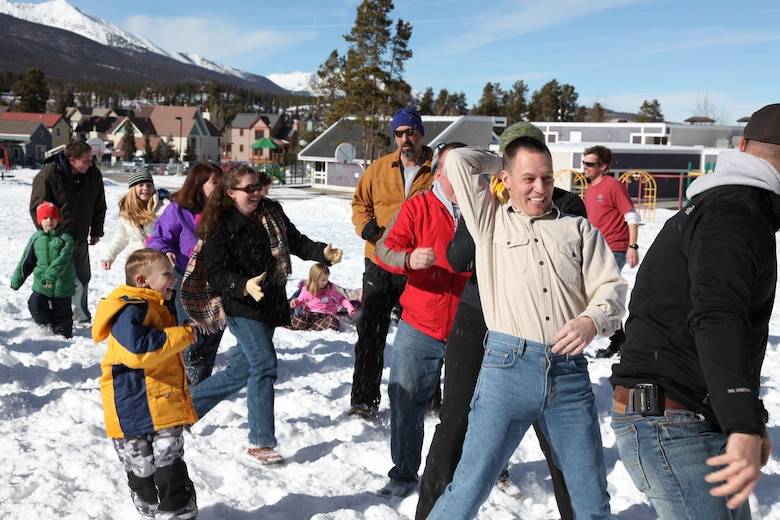 Maj. Jerry Becker, COARNG, passes a rubber chicken to a player behind hime during Family Games at the Colorado National Guard Yellow Ribbon Reintegration Retreat, Breckenridge, CO.  Members and their families, as well as members of the Colorado National Guard Family Support Group attend a family retreat in Breckenridge. Children were taught to snowshoe, families participated in outdoor games and exercises. (U.S. Air Force photo/Technical Sgt. Kevin Coulter) (RELEASED)